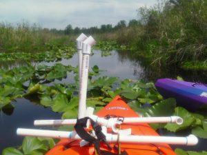 Lee Cuesta kayak in Catherine Creek wetlands of Lake Cassidy.